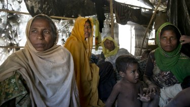 Women and children in a makeshift house they share with six others in a Rohingya refugee camp in Cox's Bazar, Bangladesh, after fleeing from Myanmar's Rakhine state.
