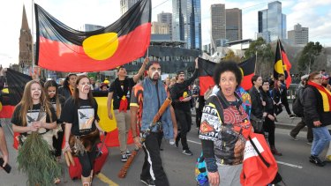 Protesters rally against the closure of Aboriginal communities.