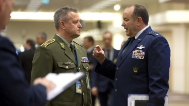 Supreme Allied Commander Europe, General Philip Breedlove, right, speaks with Czech Republic's NATO-EU military representative Major-General Miroslav Zizka, prior to a two-day meeting of NATO defence ministers in Brussels on Wednesday.