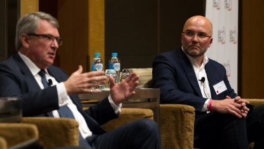 Lynton Crosby, left, and Mark Textor address the Australian British Chamber of Commerce in Sydney in August.