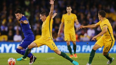 Andreas Samaris of Greece and Mark Milligan of the Socceroos compete for the ball during the friendly at Etihad Stadium on Tuesday night.