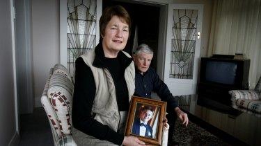 Karen and Stephen Breckenridge with a photo of their son David.
