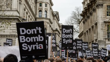 Anti-war signs crowd the skyline outside Downing Street on the weekend oppose British involvement in the bombing of Syria.