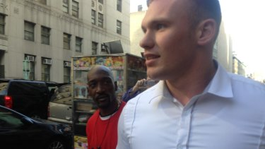 Matthew Lodge is questioned by a bystander in New York after leaving court.