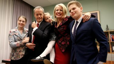 Opposition Leader Bill Shorten poses for photos with his family ahead of his budget reply speech.