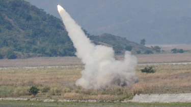 A US-made rocket system fires in Crow Valley, Philippines. US and the Philippines, which is locked in a dispute with China over part of the South China Sea, conduct annual joint military exercises.