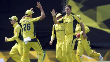 Million dollar man: Mitchell Marsh (right) played a leading hand in Australia's win over the Black Caps in Wellington.