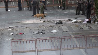 Police investigate the scene the morning after the explosion.