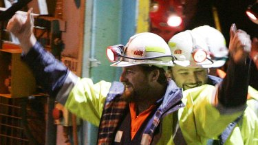 Miners Todd Russell, left, and Brant Webb, smile as they emerge from Beaconsfield mine.