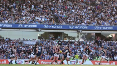 A packed crowd at Princes Park watches Carlton play Collingwood on Friday.