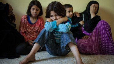 Jouri weeps as her aunt recounts their family's harsh journey after they were forced to flee their home in Syria.
