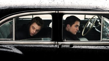 Robert Pattinson, right, as a struggling photographer, steals the show from Dane DeHaan as James Dean in <i>Life</i>.