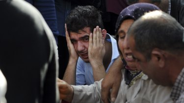 Relatives of people wounded in Ankara await news of their loved ones at a hospital on Saturday.