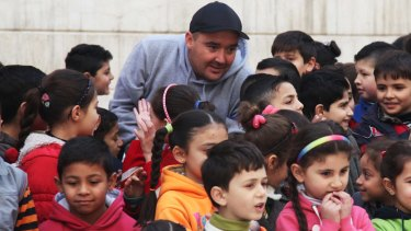 Luke Cornish in Syria where he has been using street art to help children.