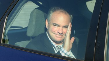 Virginia Senator Tim Kaine waves to the crowd before attending a private fundraiser event in Newport, Rhode Island, hosted by fellow Democratic Senator Jack Reed.