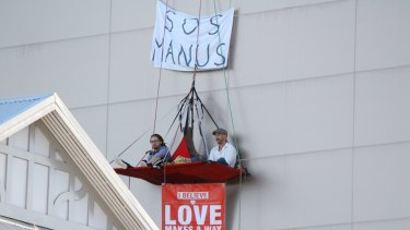The protesters suspended above Julie Bishop's Perth office.