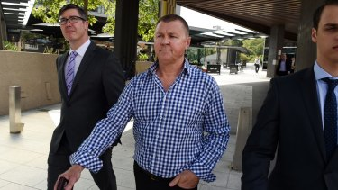 Former trade union boss Dave Hanna (centre) leaves the Magistrates Court during royal commission hearings.