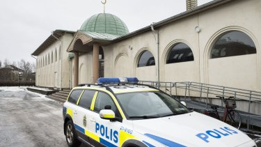 Police car in front of a mosque in Uppsala, Sweden, after a burnt-out Molotov cocktail was found early on Thursday.