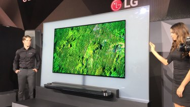 """LG's super-thin """"wallpaper"""" OLED television, on show at CES in Las Vegas."""