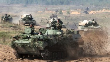 Belarusian army vehicles prepare for war games with Russia at an undisclosed location in Belarus.