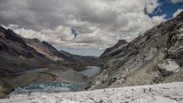 Glacier researchers at work, bottom right, on Gueshgue glacier, in the Cordillera Blanca region of Peru.