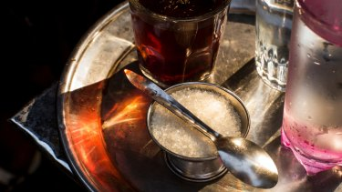 A bowl of sugar, as it is traditionally served with tea in Egypt, on a street in Cairo.