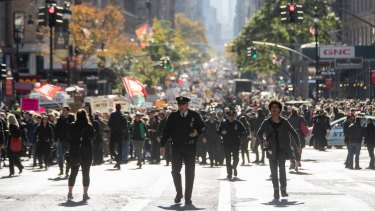 Demonstrators march up Fifth Avenue in New York during a mass protest against the election of Donald Trump.