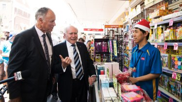 Liberal incumbent John Alexander campaigns with former prime minister John Howard at an Eastwood chemist.