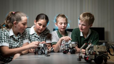 Mitcham Primary School students Megan, Hailey, Jordan and Aidan have been programming robots to boost their science and maths skills.