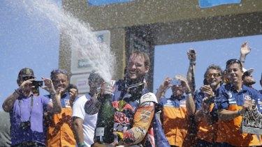 Champagne moment: Toby Price celebrates.