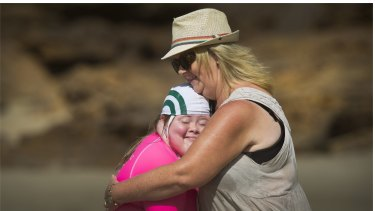 Georgia Brown, 12, and her mum Caroline. Georgia is part of Starfish Nippers program run at the Anglesea Surf Life Saving club for young people with disabilities.