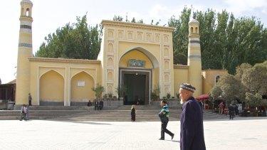 An elderly Uighur man in front of Kashgar's Id Kah mosque, Xinjiang, China.