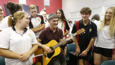 Freedom Ride 2015: Singer Paul Kelly sings a song with Dubbo school students at Dubbo Senior Campus.