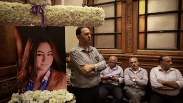 Friends and relatives of EgyptAir hostess Yara Hani, who was working aboard flight MS840, mourn during a ceremony at a church in Cairo on Saturday.