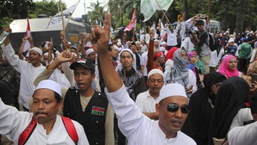 Indonesian Muslims  demonstrate outside the court where Jakarta Governor Basuki Tjahaja Purnama, also known as Ahok, is facing blasphemy charges.