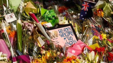 Flowers and messages left outside the  Lindt Cafe in Sydney after last month's seige.