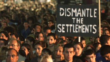 Israelis take part in a rally marking the sixth anniversary of Rabin's assassination.
