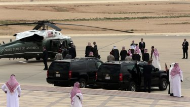 Mr Obama greets Saudi officials on his arrival in Riyadh.