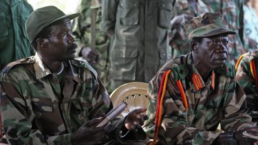 Lord's Resistance Army leader, Joseph Kony, left, and his deputy Vincent Otti sit inside a tent at Ri-Kwamba in Southern Sudan in 2006.