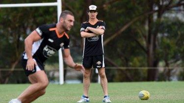 Uneasy alliance: Robbie Farah and coach Jason Taylor.