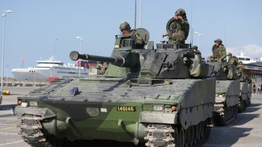Swedish armored personnel carriers in Visby harbour on the island of Gotland, Sweden.