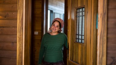 Inbal Zeev, owner of 'Bikta Bakerem' bed and breakfast, which is advertised on Airbnb international home-sharing site and rental listings service, at the entrance to her property in the West Bank Jewish outpost of Esh Kodesh last week.