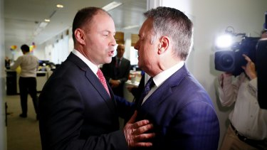 Environment and Energy Minister Josh Frydenberg debates coal policy with Labor MP Joel Fitzgibbon in the press gallery.