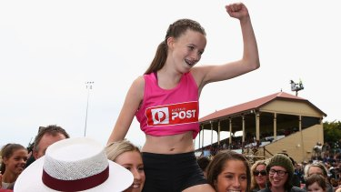 Talia Martin (pink) won the women's Stawell Gift in controversial fashion.