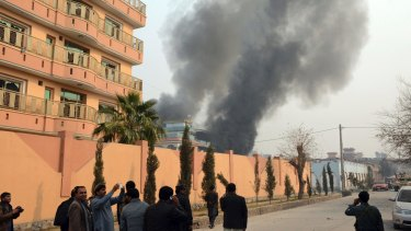 Smokes rises after a deadly suicide attack in Jalalabad, east of Kabul, Afghanistan on Wednesday.