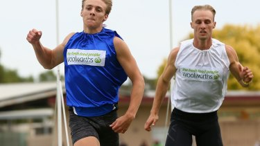 Victor: Isaac Dunmall (left) etched his name into history in winning the Stawell Gift on Monday.
