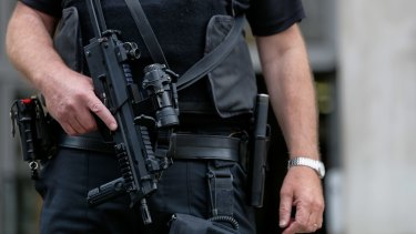 An armed British police officer on security patrol outside the Ministry of Defence in London earlier this month.