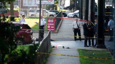 Sandals lay on a street corner at the crime scene where two men were shot dead.