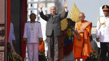 Cambodia's King Norodom Sihamoni waves to well-wishers at Independence Day celebrations in Phnom Penh last week.