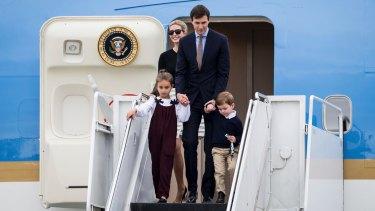 Ivanka Trump, her husband Jared Kushner and their children disembark Air Force One in Florida.